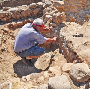 Archaeologist points out excavated layers revealing history
