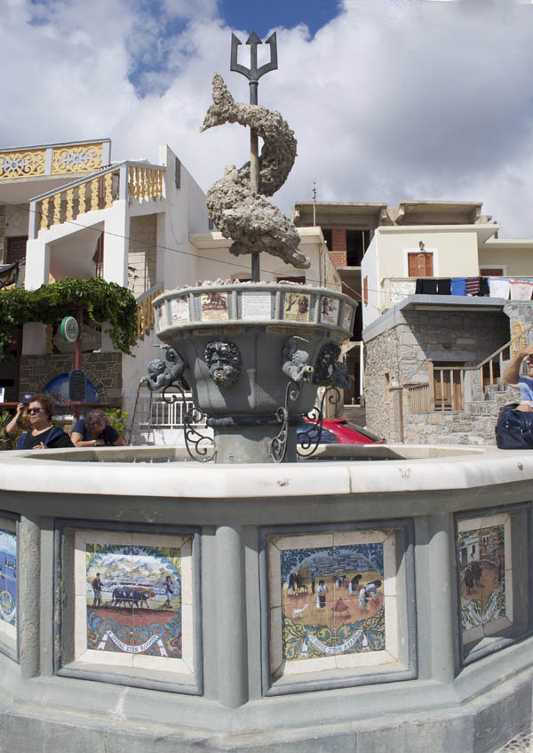 Waterfront fountain depicts traditional Karpathian life