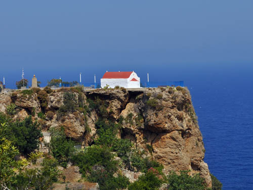 Old church is perched on a vertical cliff above the sea
