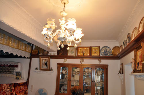 On all the walls were shelves lined with family memorabilia