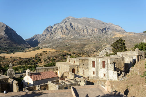 Kato Preveli Monastery is located in the foothills and surrounded by farmland.